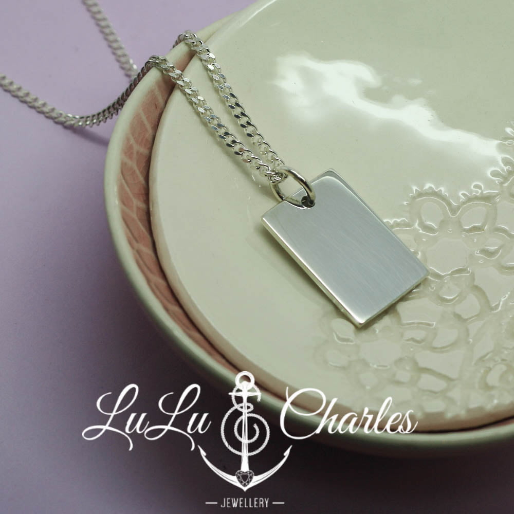Personalised Dog Tag containing cremation ashes, handmade in sterling silver
