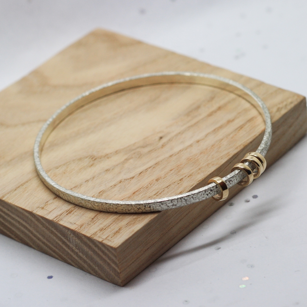 Handmade Sterling Silver Textured Bangle with 9ct gold rings, for 40th birthday present