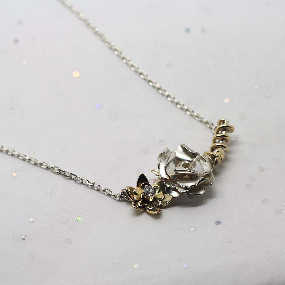Handmade bespoke necklace by LuLu & Charles Jewellery for a silver english rose & entwined 9ct gold daffodil necklace.
