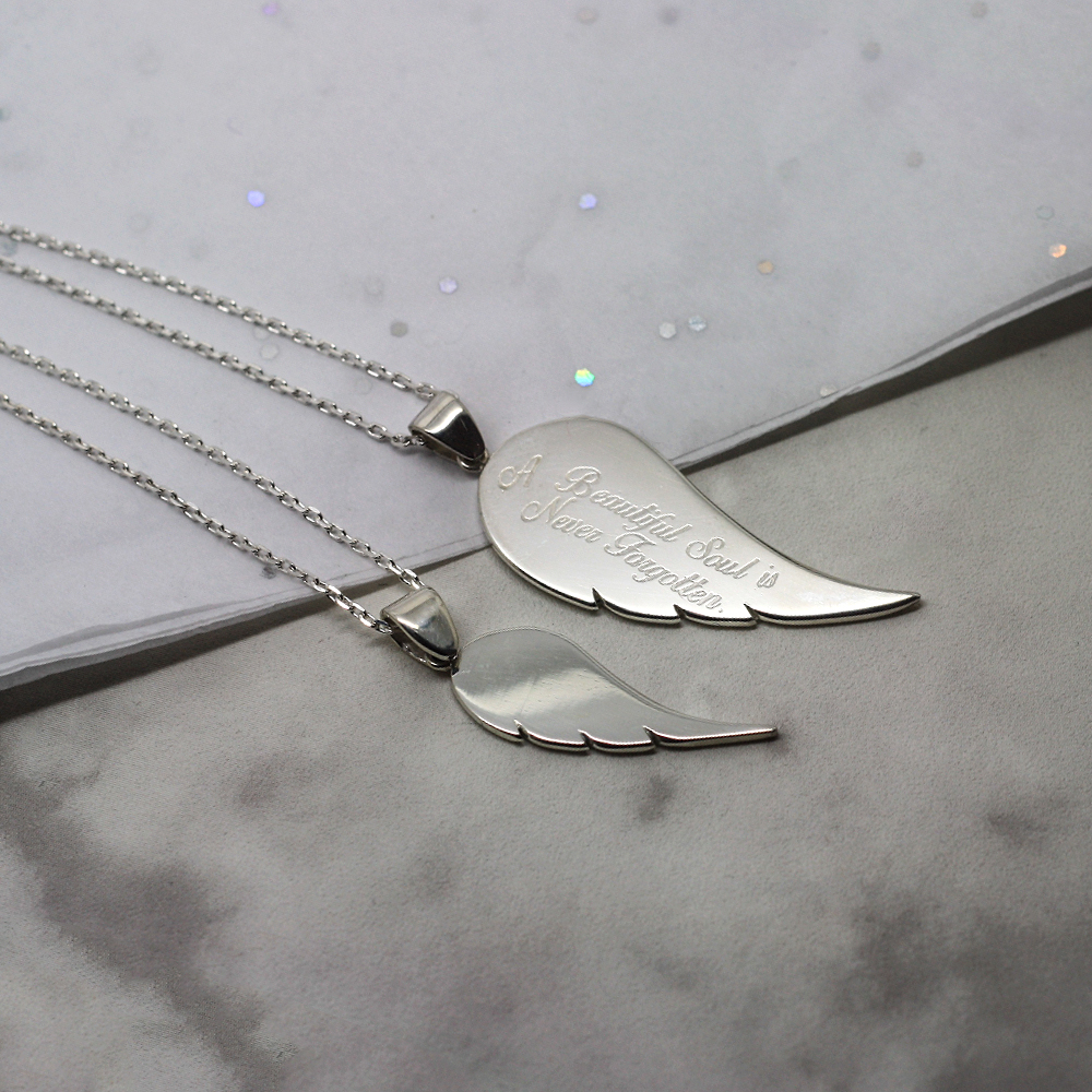 Handmade Sterling silver personalised angel wing necklace, handmade contemporary memorial jewellery uk, by lulu charles jewellery, bespoke handmade jewellery uk