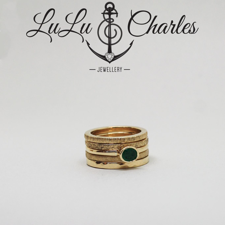 Handmade 9ct Yellow Gold Textured Stacker Rings with Handmade 9ct yellow gold Emerald Ring by lulu & charles jewellery uk
