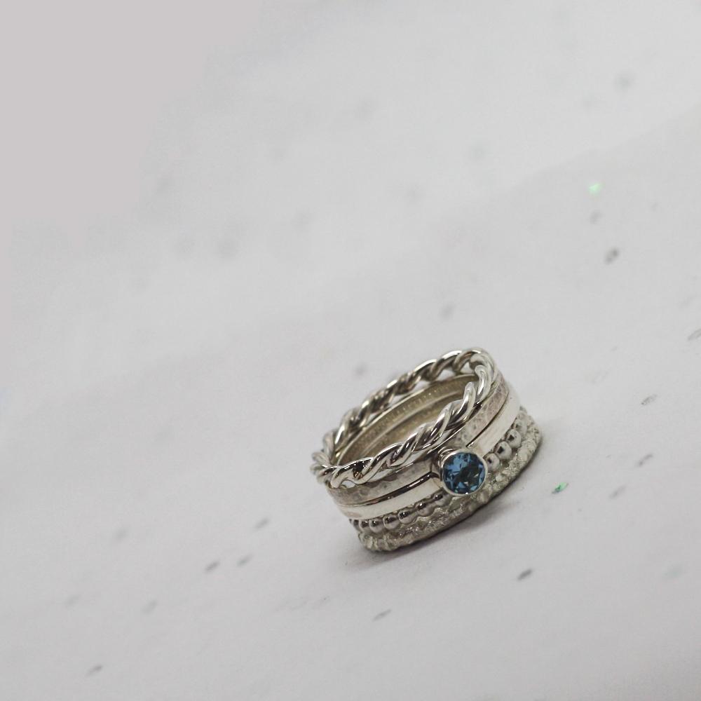 handmade sterling silver aquamarine solitaire stacker ring by lulu charles jewellery, handmade silver jewellery uk
