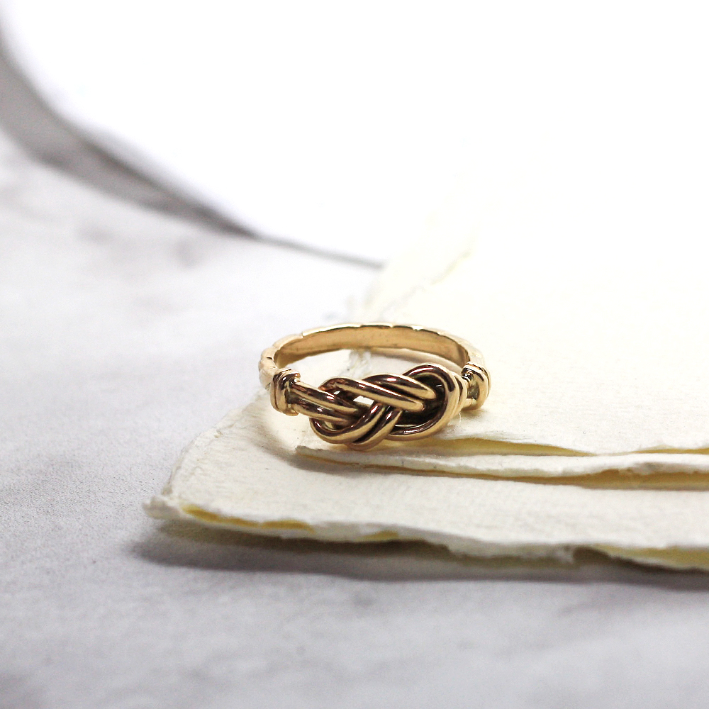 Handmade Gold lovers knot ring, handmade and remodelled using sentimental gold jewellery, remodelled gold jewellery count durham england.