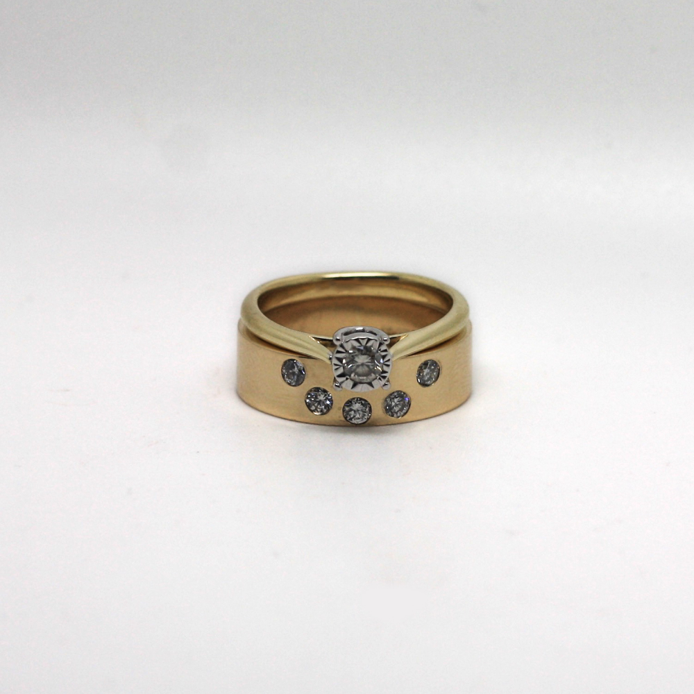 Handmade ladies wedding ring, shaped to fit engagement ring, remodelled using customers own 9ct gold. Stone set with five diamonds.