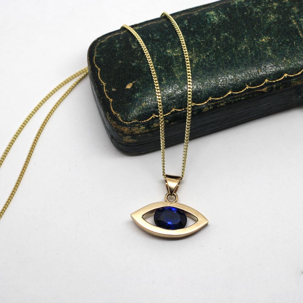 9ct gold handmade evil eye necklace, set with a blue spinel, bespoke handmade jewellery by lulu & charles jewellery, newcastle, county durham, uk.