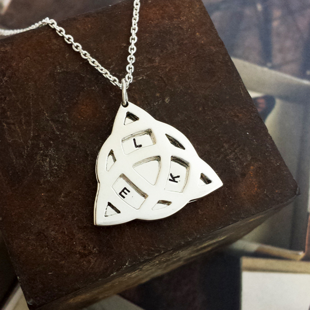 Handmade Sterling Silver Personalised Triquestra Pendant, hung from a diamond cut trace chain.